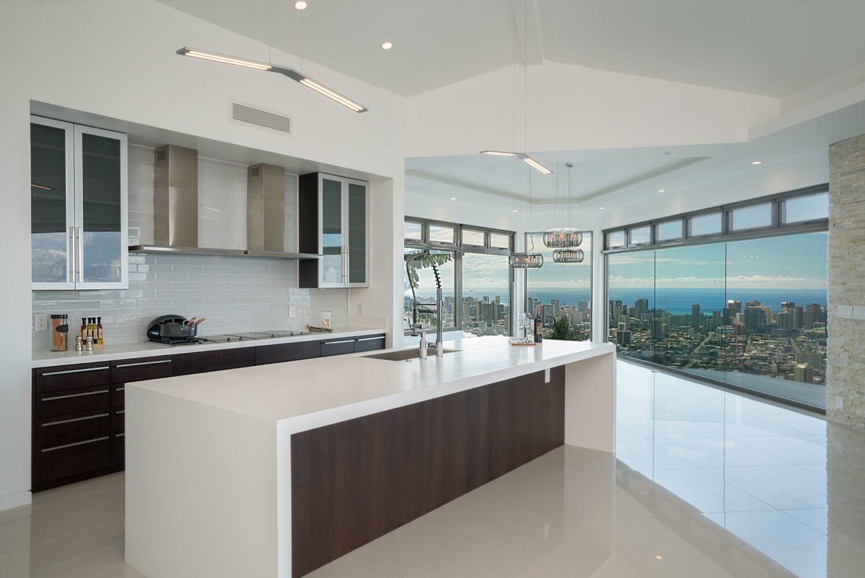 The Ultra Modern Kitchen Overlooks The Open Floor Plan Allowing