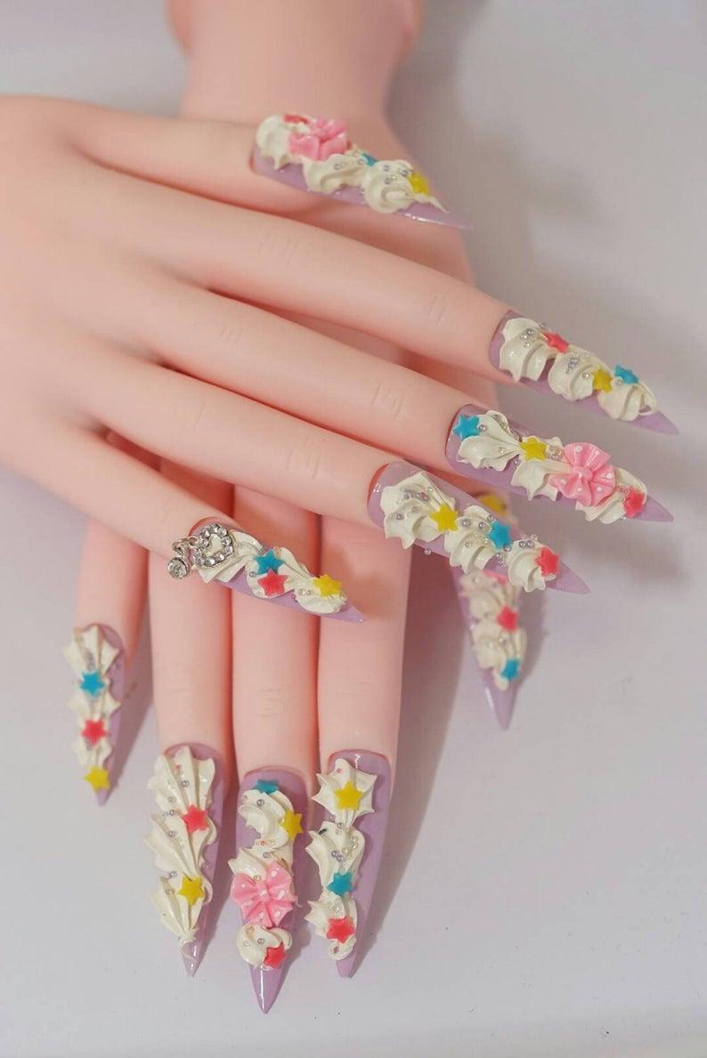 Photo of Nails, stiletto nails, super long nails, fairy kei, Japanese nails, 3D nails, kawaii, pastel, fake sweets, yume kawaii, drag queen, cream
