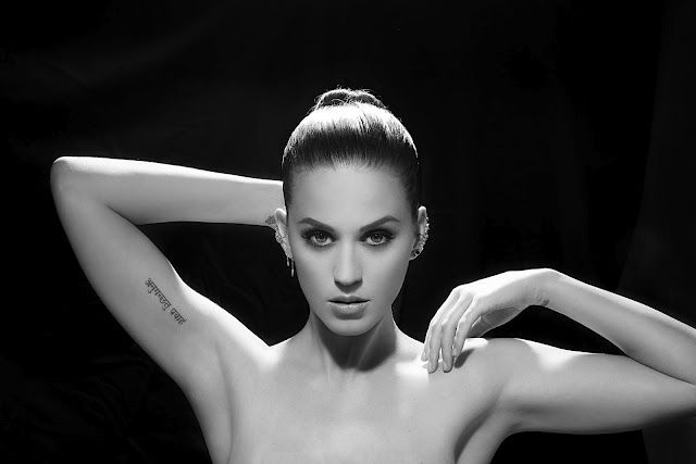 """Katy Perry's. The tattoo says """"Anuugacchati Pravaha"""" which means """"Go with the flow"""" in Sanskrit. She has 3 tattoos else: Jesus on her wrist - a strawberry on her ankle - a peppermint on her ankle."""