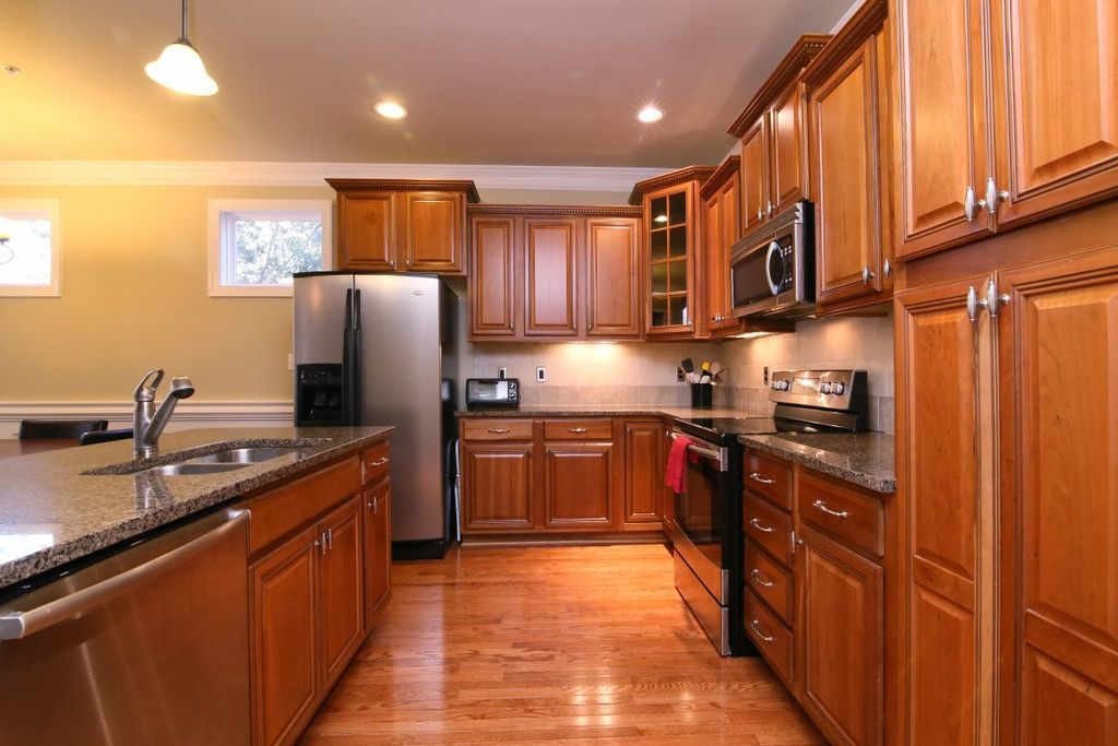 Traditional Kitchen with Crown molding, Kitchen island, flush light ...