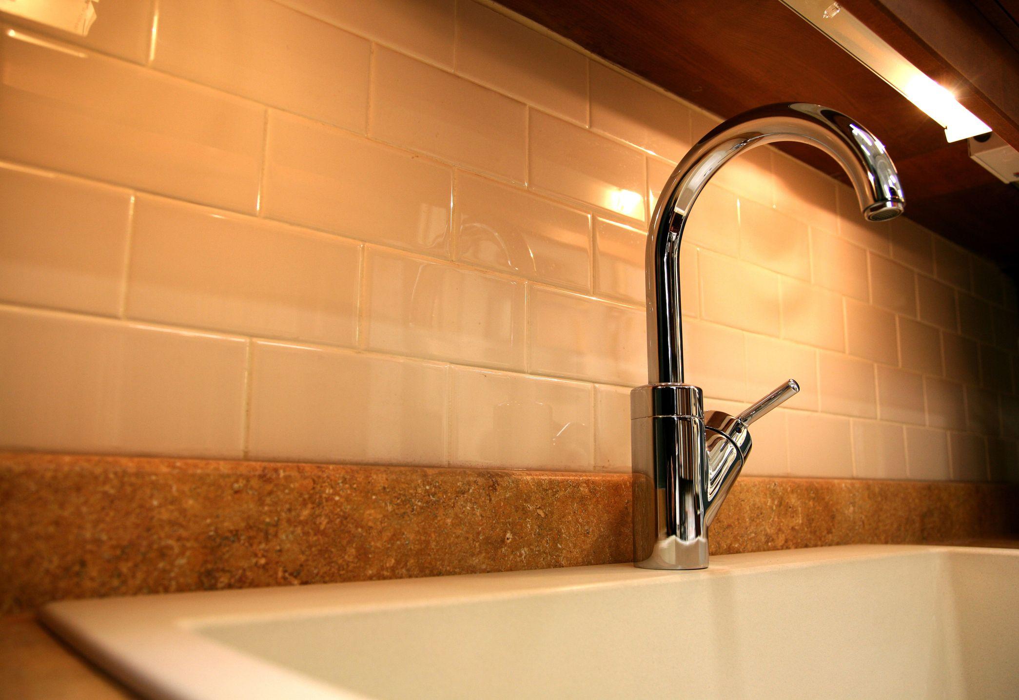 How to Cover an Unattractive Gap Between a Granite ... on Best Backsplash For Granite Countertops  id=69487