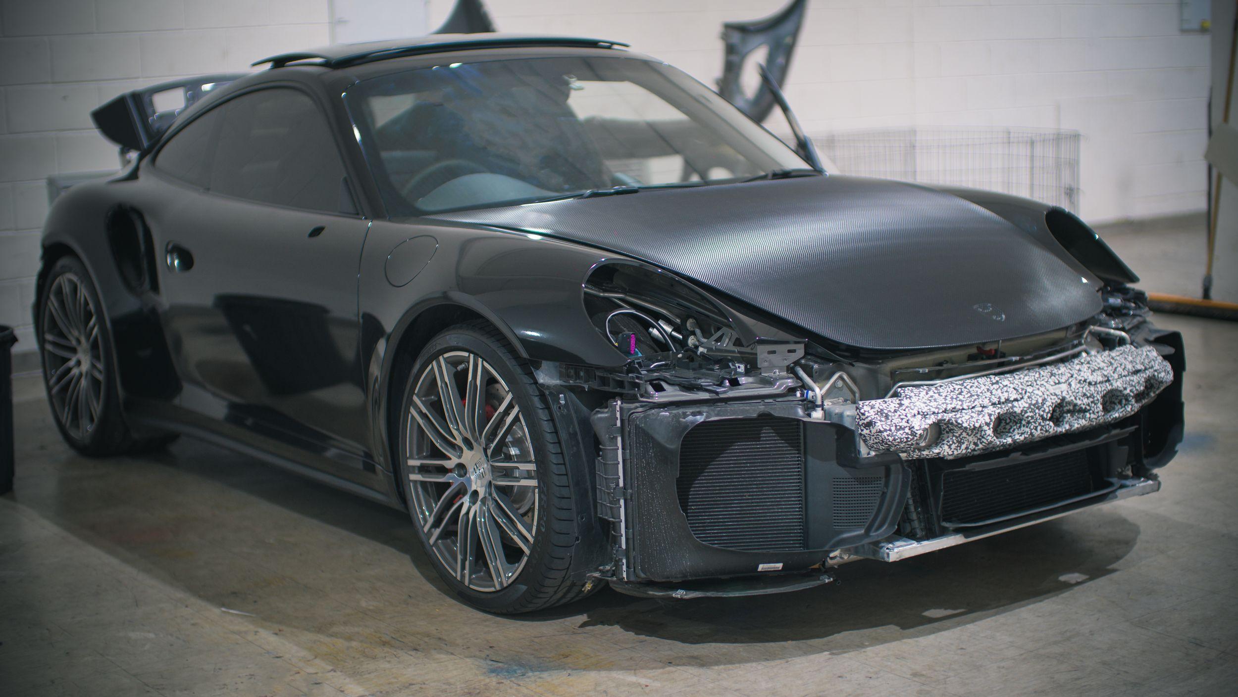 Custom black gloss wrap on this beautiful porsche car