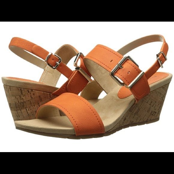 NEW Orange Bandolino Slingback Wedge Sandals NEW IN BOXBandolino Slingback Wedge SandalsSize 9Beautiful Summer Orange ColorAdjustable Strap For Perfect ComfortOpen ToeDouble Buckle Closure at AnkleFaux Leather/Synthetic Lining/ Footbed/Outsole2 1/2 Inch HeelGreat Shoe! Retails $59 Bandolino Shoes Sandals