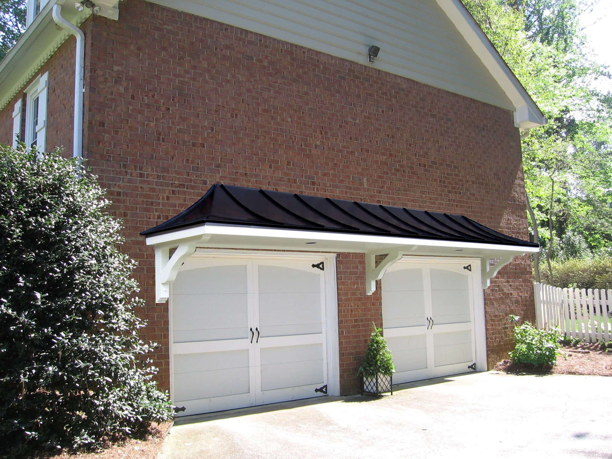 Metal roof portico over double garage doors designed and for Two door garage