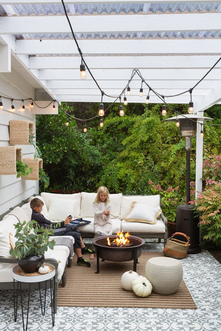 Cozy And Neutral Patio Set For Fall Zevy Joy Beautiful Modern Farmhouse Styled Fall Decorated Patio With A Copper Fire Pit Whi Patio Set Patio Patio Decor