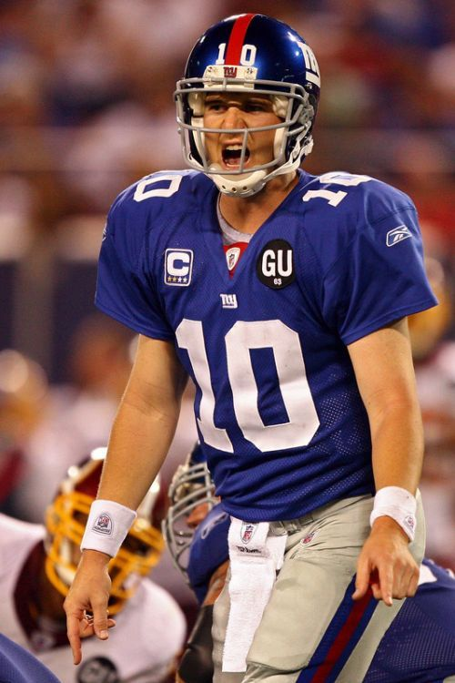 "Elisha Nelson ""Eli"" Manning (born 01/03/81) is an American football quarterback for the NY Giants of the Nat'l Football League. He is the son of former NFL quarterback Archie Manning & younger brother of Denver Broncos quarterback Peyton Manning."