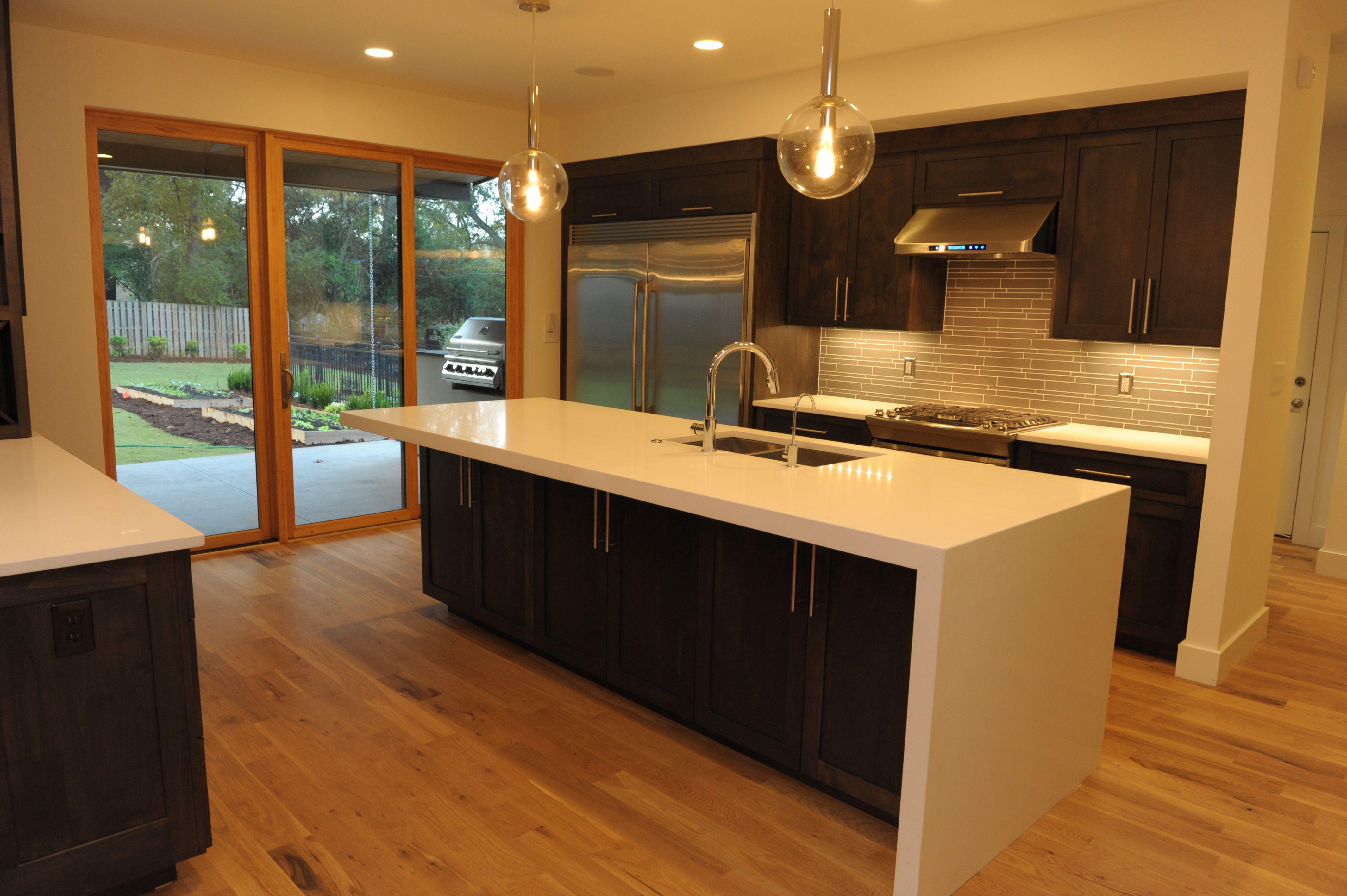quartz waterfall island parallel kitchen layout waterfall island kitchen kitchen layout on kitchen island ideas white quartz id=11633