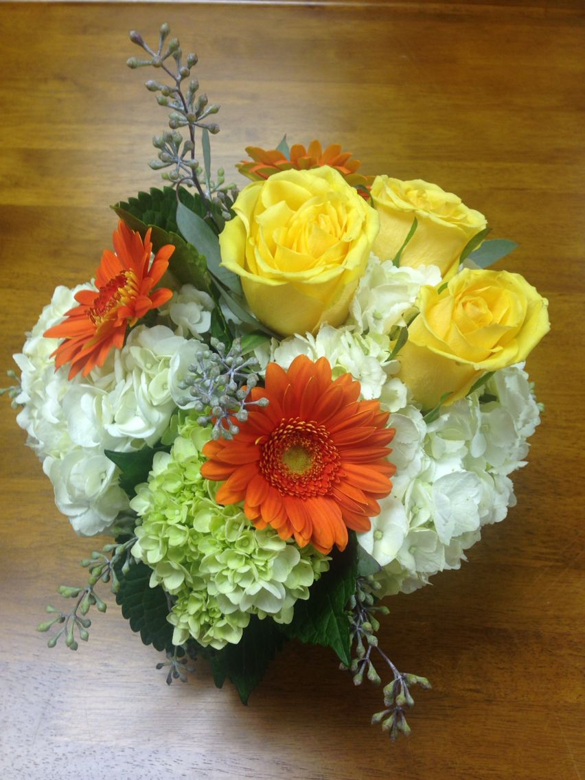 Gorgeous classic fall bouquet or centerpiece with roses, hydrangea and gerbera daisies!