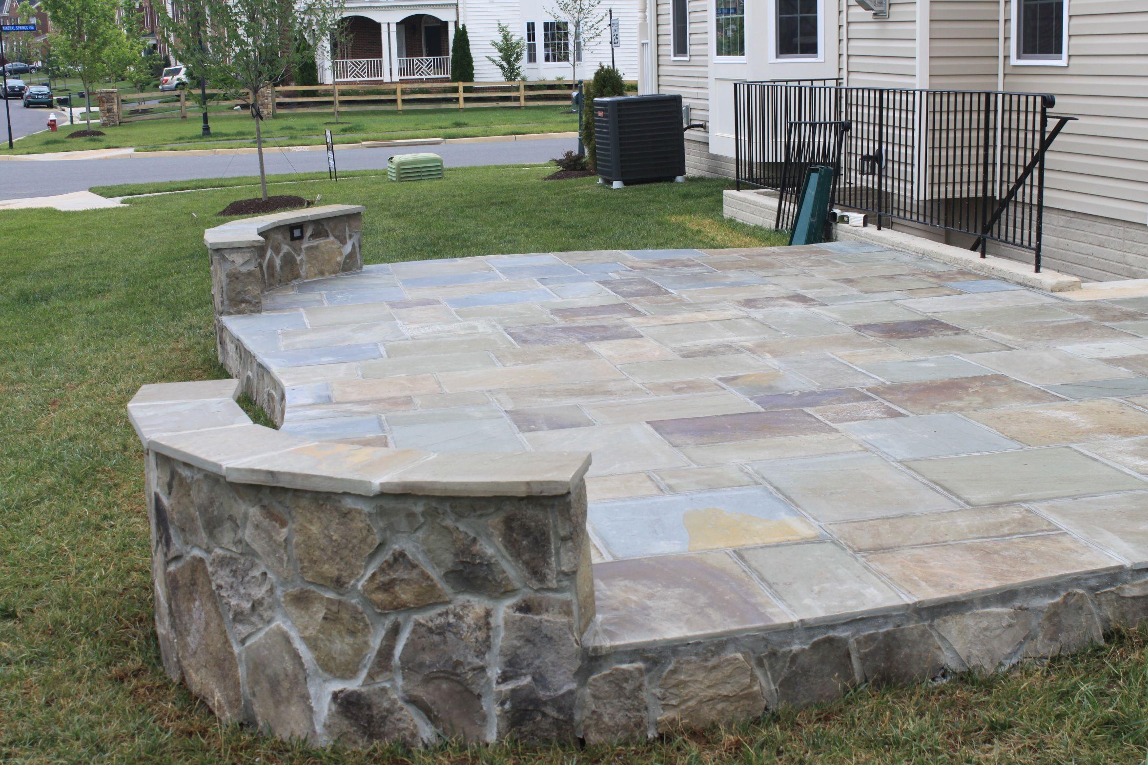 An PA slate patio with irregular flagstone sitting wall in ...