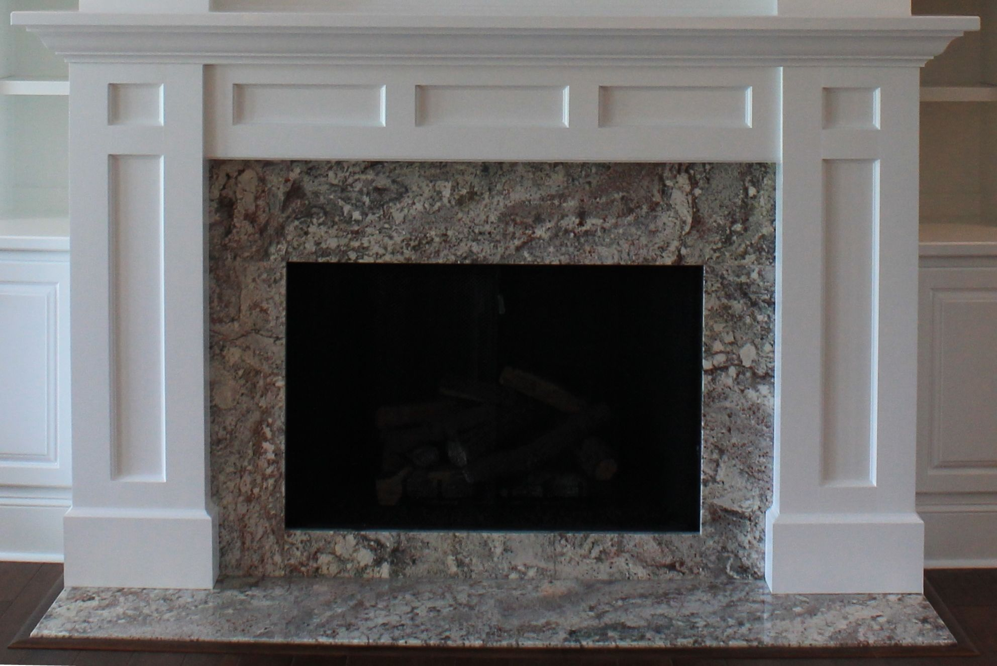 A Atlanta Mantel Shown With Granite Surround And Flush Hearth