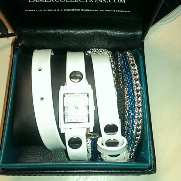 **NEVER WORN** La Mer Wrap watch Super hot white patent leather la mer wrap watch. Yet another watch strap not available on the la mer site anymore. Never worn except to try on a couple times!!! Silver watch face with white background, silver buttons on strap. Chains featured are silver, white, black, and blue. It's a gorgeous watch ive just never gotten around to wearing it. Comes with its watch box! FYI 2nd and 4th pics not of my watch but THE watch. Mine is in way better condition than…