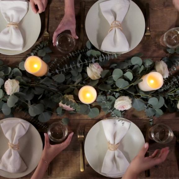 Take your dinner party to the next level with a gorgeous DIY eucalyptus garland. It's easier than you think! We'll show you how to make and display this garland in under an hour. #eucalyptus #diygarland #garlandofflowers