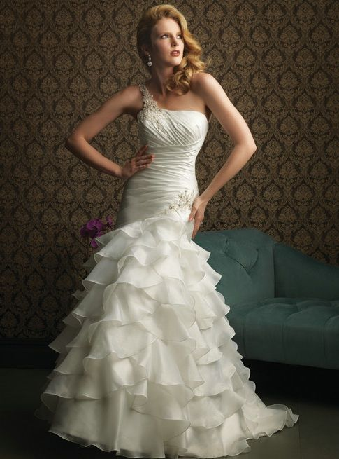 Ruched Wedding Dress with Tiered Ruffle Skirt | #weddingdresses #weddinggowns #bridalgowns #bridaldresses #bridal #fashion #gowns | This one shoulder bodice wedding gown is ruched at an angle. It is fitted just past the hip then it falls into tiered ruffle skirt that flares | ---- We can make this for you in any size or with any changes | Custom designs & replicas also available | www.dariuscordell.com