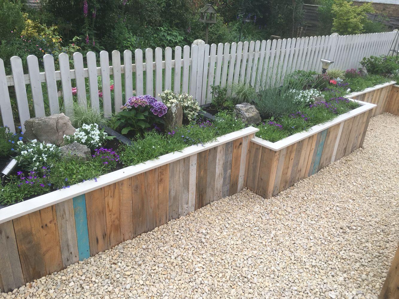 Raised pallet flower bed   Easy garden, Flower beds, Garden