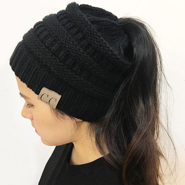 2018 CC Warm Winter Hat For Women Ponytail Beanie Stretch Cable Knit Messy  Bun Hats Soft Ski Cap Wholesale 7e6a300265e