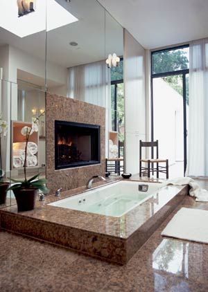 Totally love this, though the fireplace next to the bath may be a