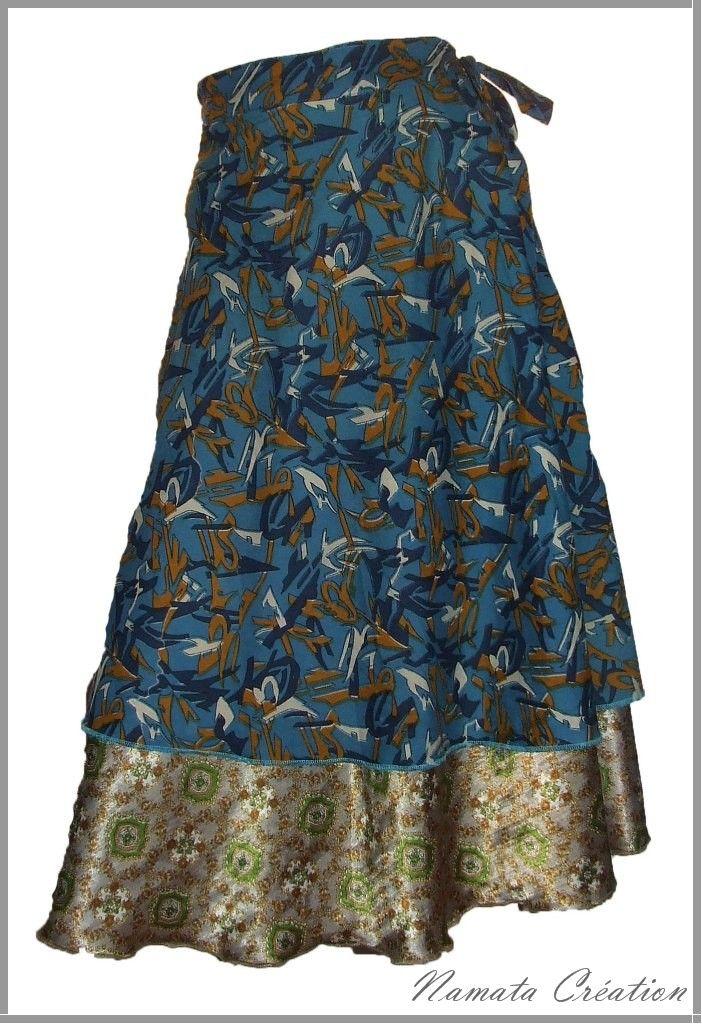 Jupe en soie superposée dans les tons de bleu, jupon double en contraste, forme portefeuille.
