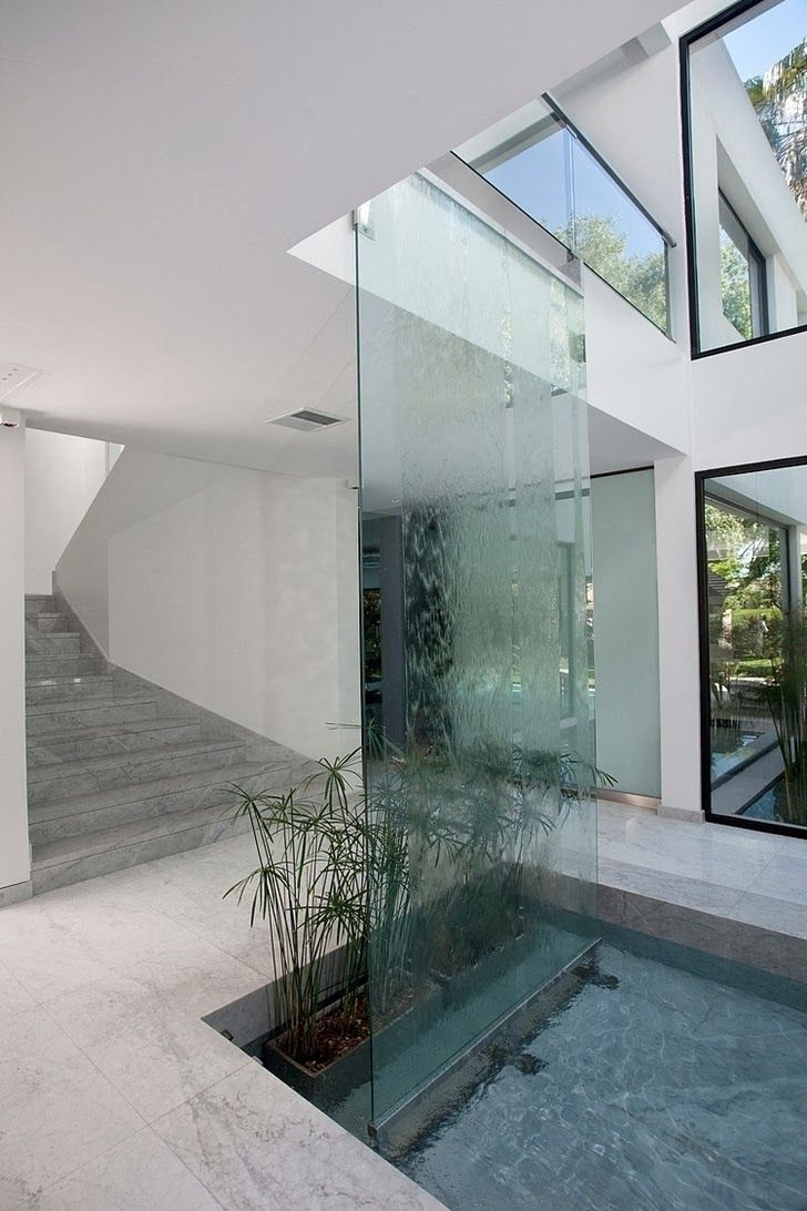Waterfall In Minimalist Casa Carrara By Andres Remy Architects Design Fur Zuhause Wasserfall Design Architektur