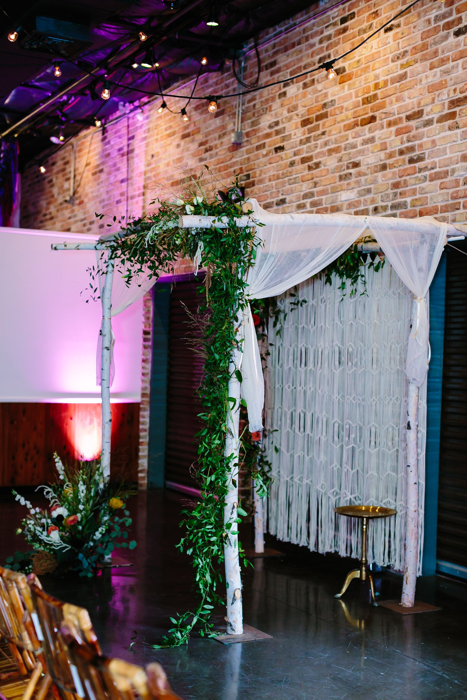 Unique Bohemian Macrame Wedding Ceremony Backdrop Backdrop With Greenery And Bright Florals Via Birch Bras With Images Event Rental Vintage Rentals Ceremony Backdrop