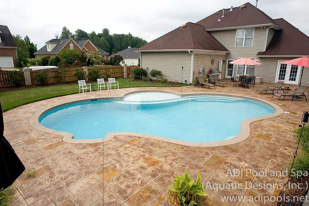 Home Pool With Stamped Concrete Pool Deck And Large Custom