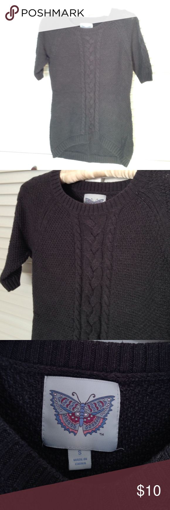 Short sleeve Sweater Grey short sleeve sweater. Not sure what brand. The bottom back of sweater is a little longer than the front by design. Perfect for fall weather... Looks great with skinny jeans and some flats... Sweaters