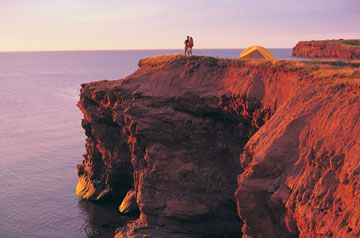 I've wanted to go here since I first saw Anne of Green Gables.  Prince Edward Island, Canada.