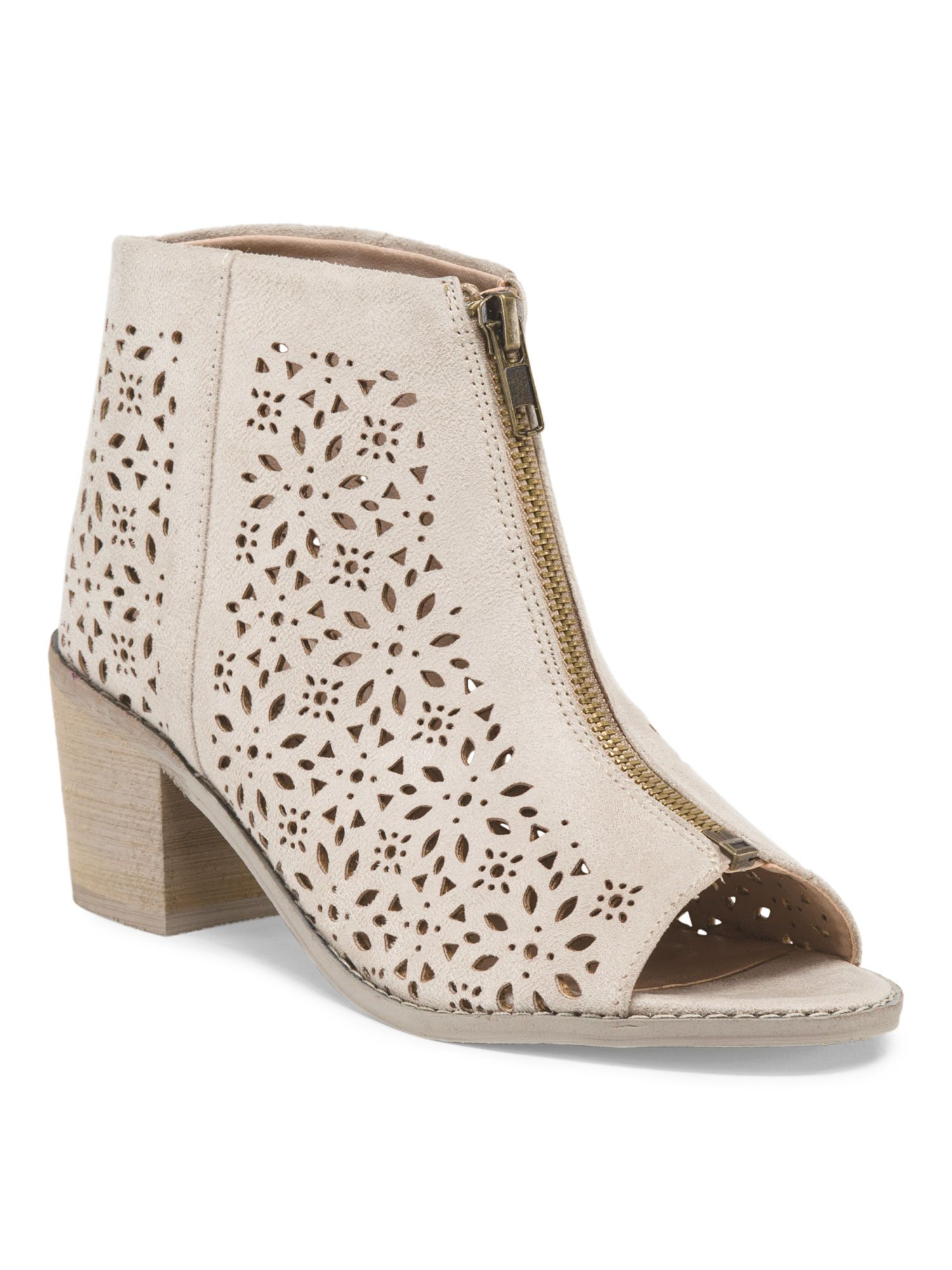 607321829 We love these peep toe booties with laser cut detailing. Perfect for jeans  or a dress!
