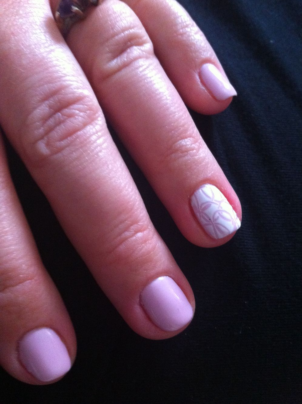 Nail art done by etching out a design with a pointy orange wood ...