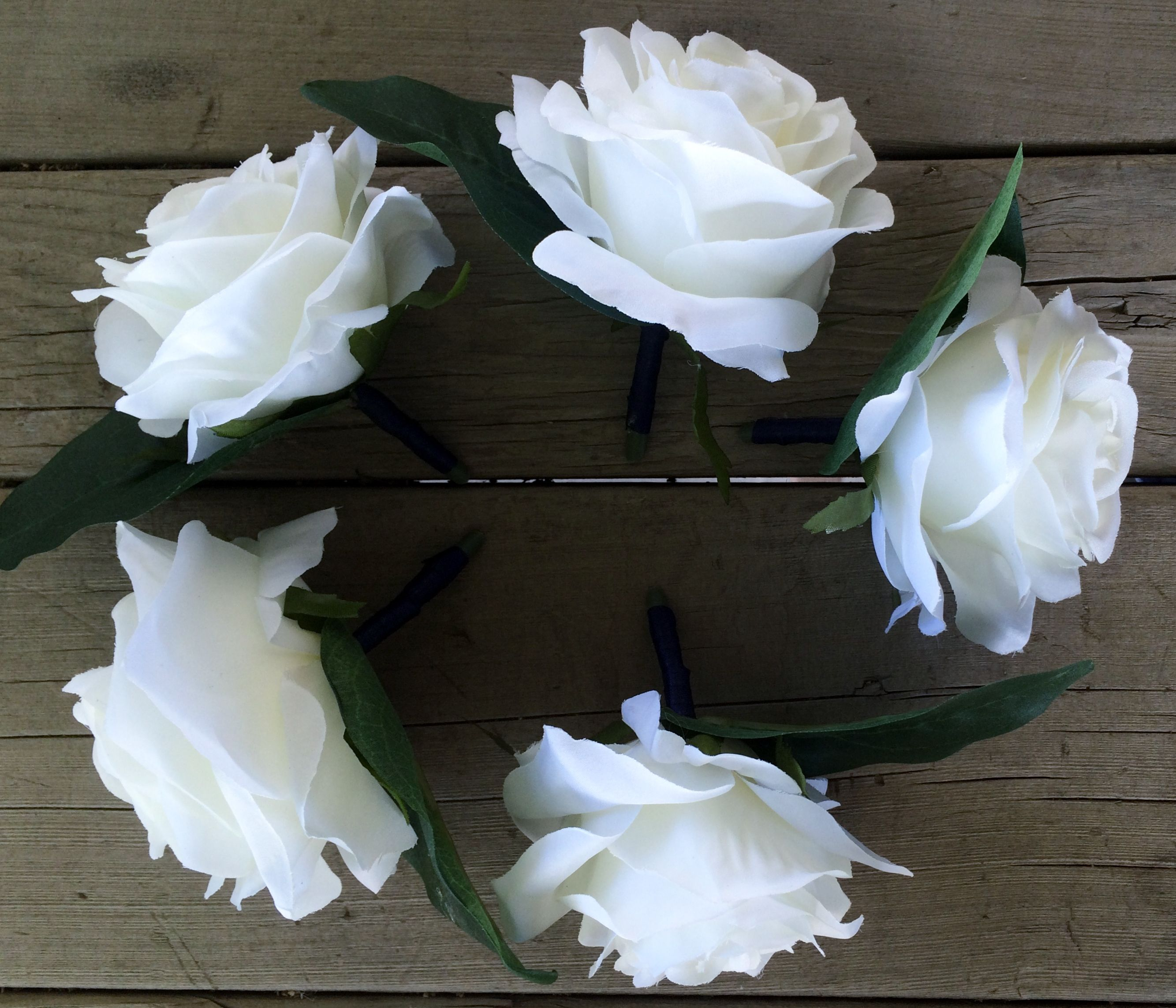 Boutonnieres.  White Roses with Navy Satin Ribbon