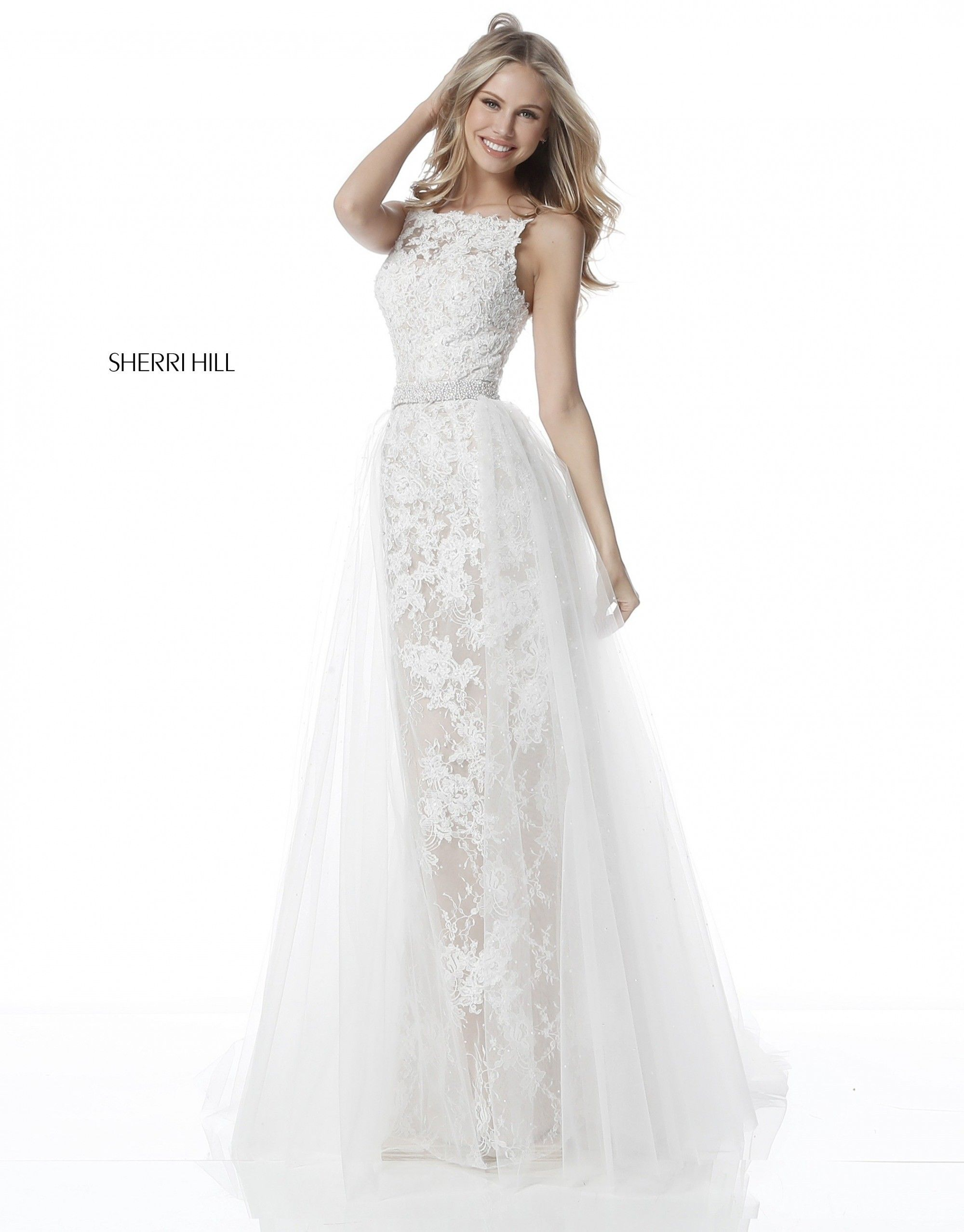 Feel like a queen in Sherri Hill 51602. This breathtaking fitted lace gown  has an attached 2c5d268a5