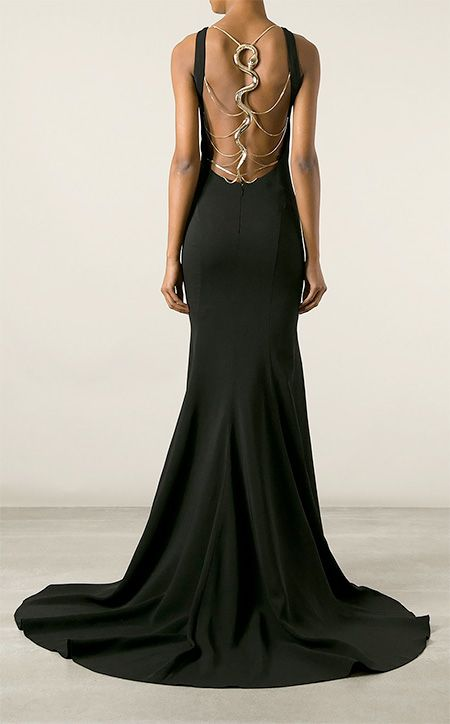 Roberto Cavalli black backless gown with the gold snake feature ...