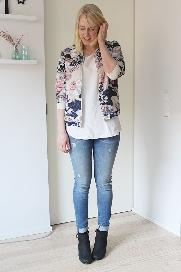 Floral bomber with blue jeans