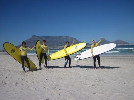 Surfing Cape Town - Get your ultimate surf experience at the beautiful beaches of Cape Town. The Stoked School of Surf Team takes you to the places with suitable swell conditions to provide good conditions for your surf lesson on your required day. Our qualified coaches are 'stoked' to get you on the board.