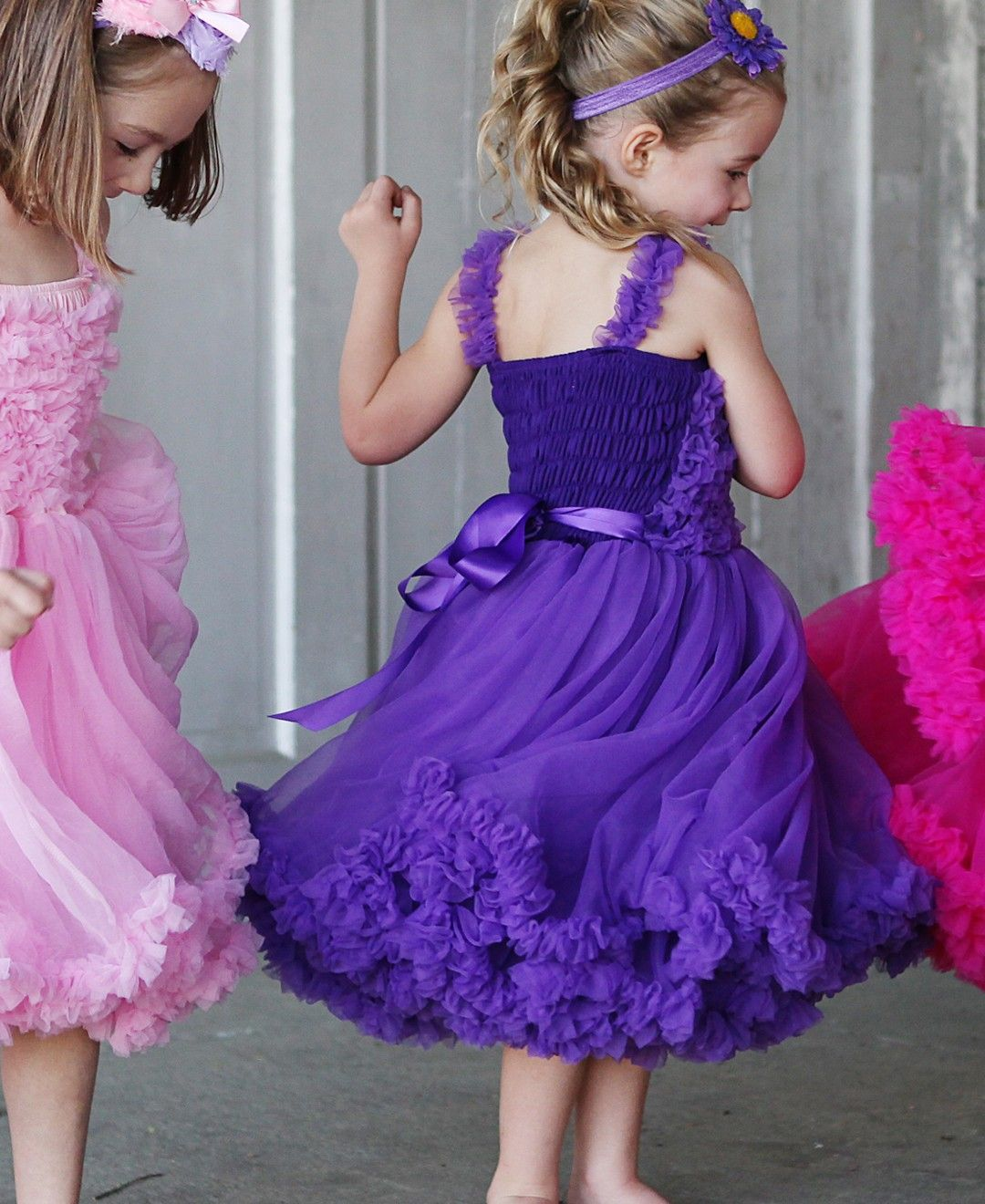 A gorgeous purple dress from Rufflebutts that will make your little girl feel positively regal. #kid #girl #fashion