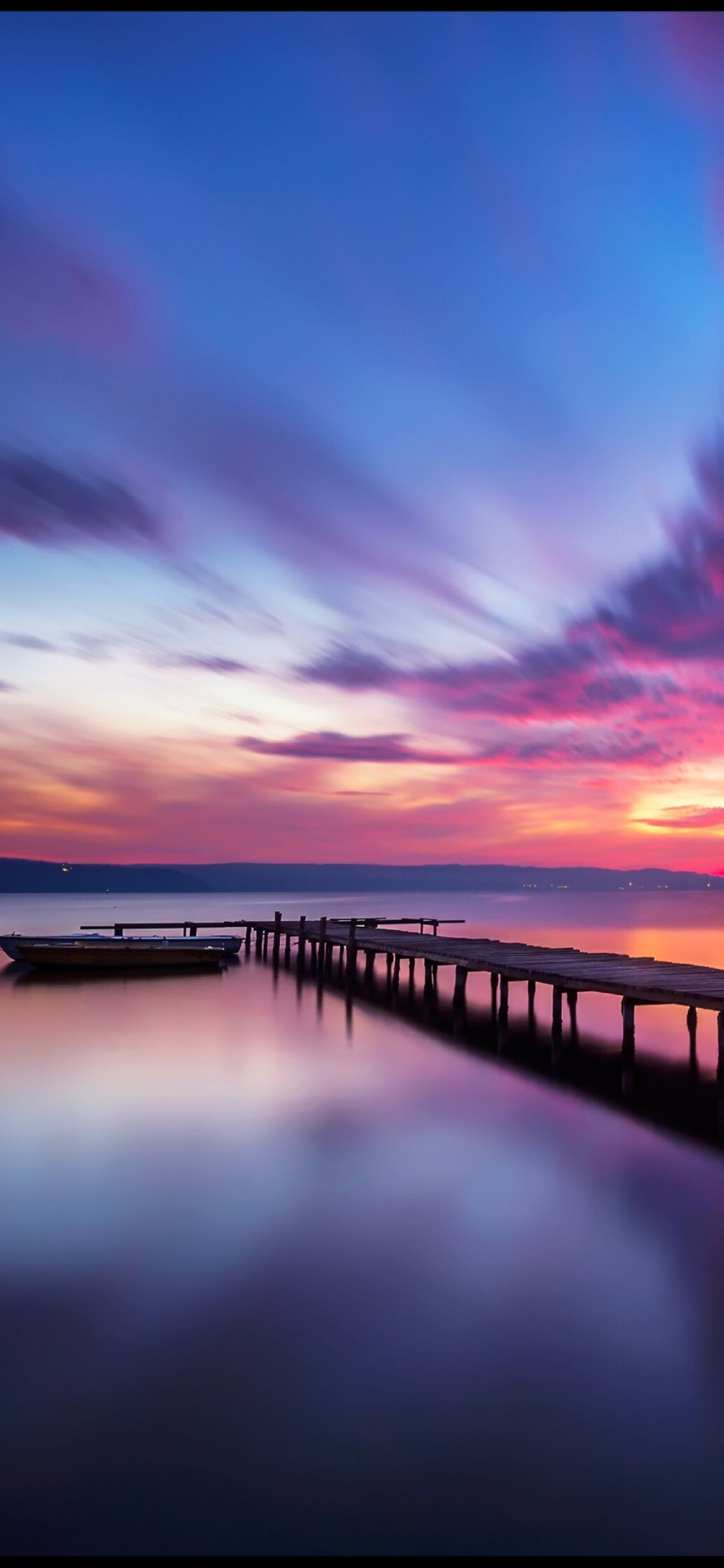 A pier into the sunset