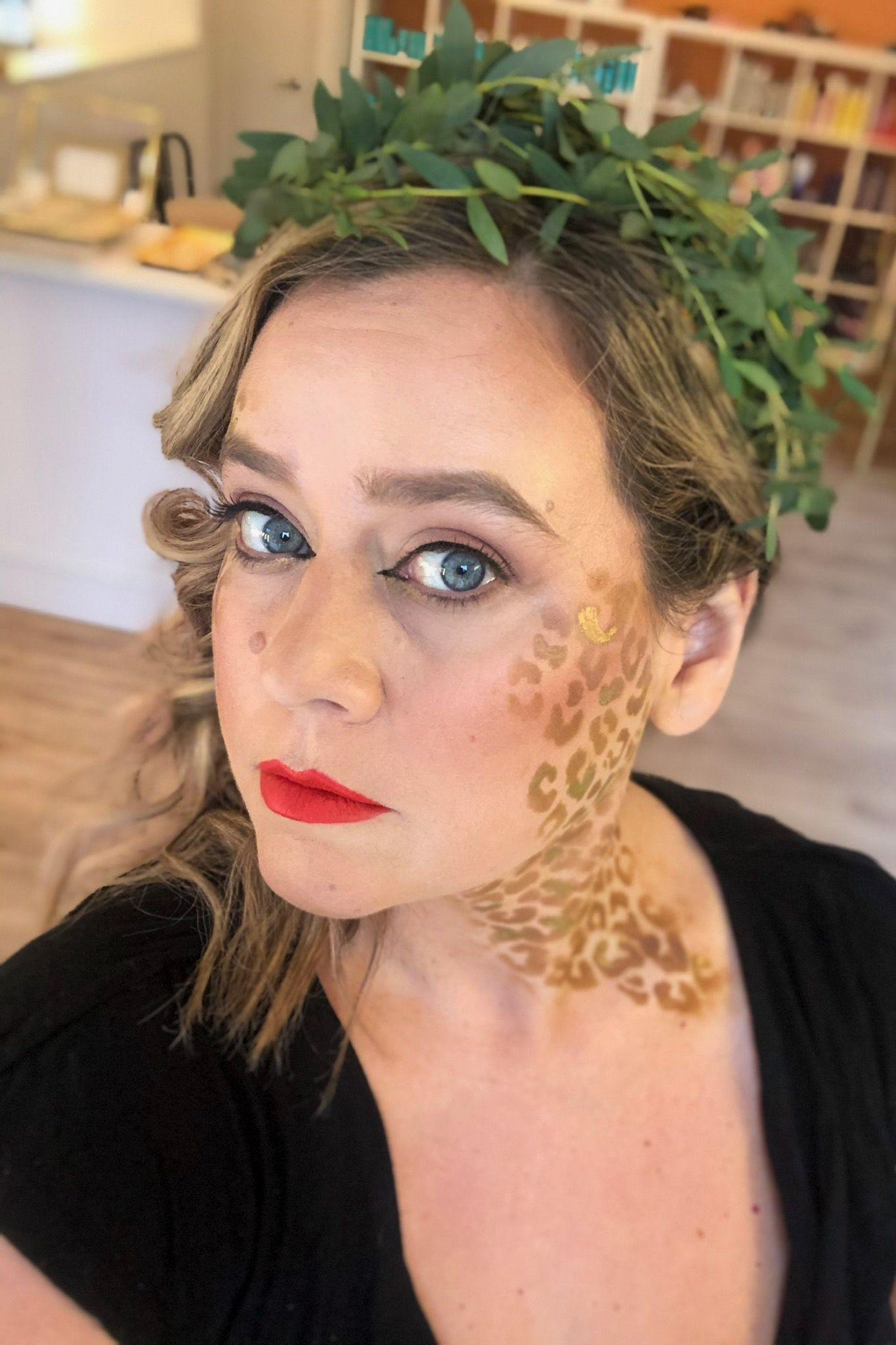 leopard queen makeup idea for Halloween hairstyle