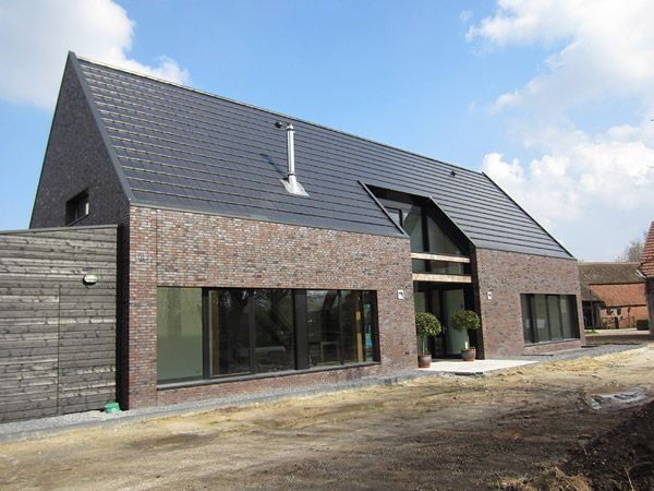 Unusual barn inspired house by Netherlands' SPOT Architecture