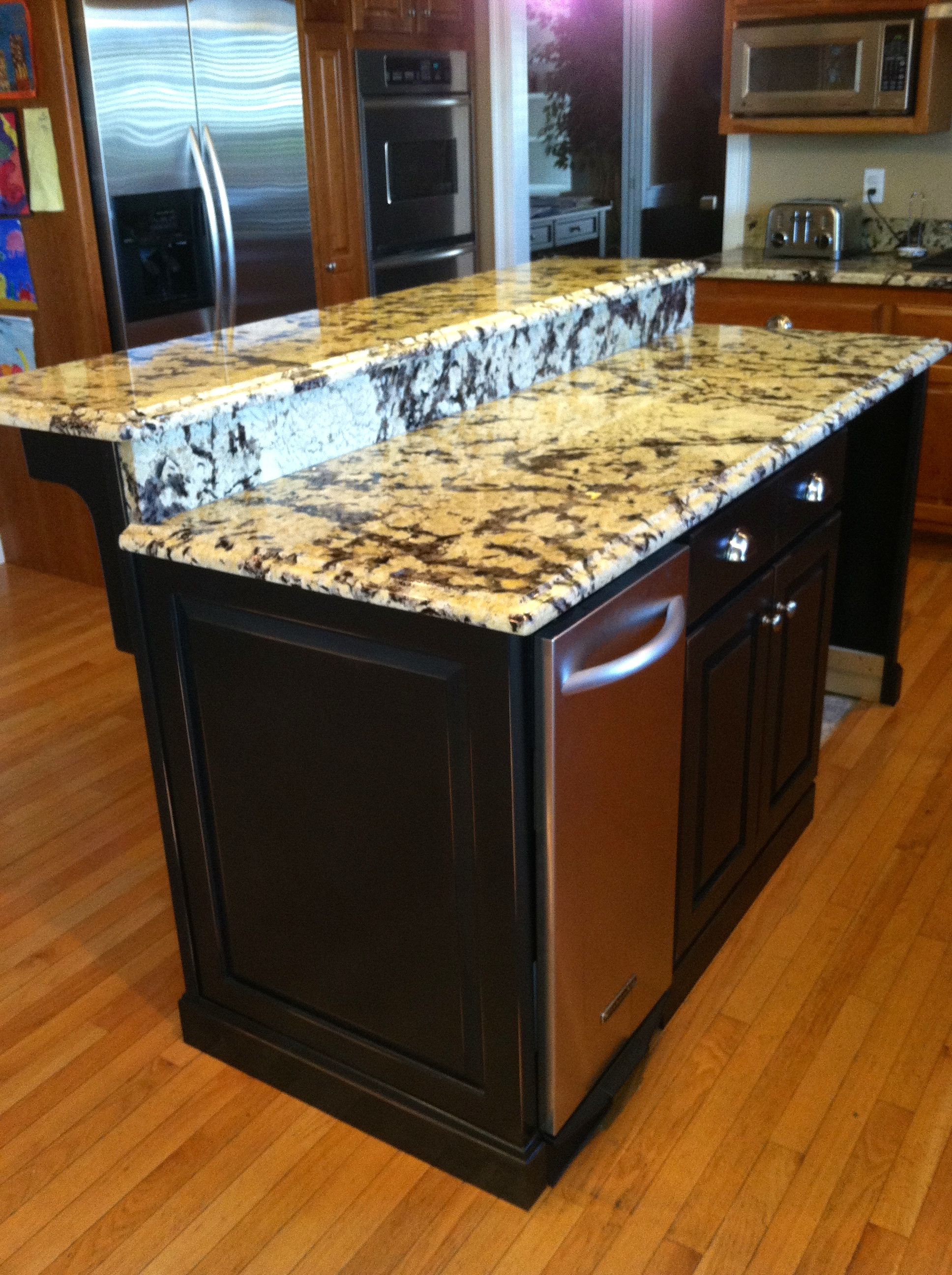 Black distressed island with an elevated bar top custom wood