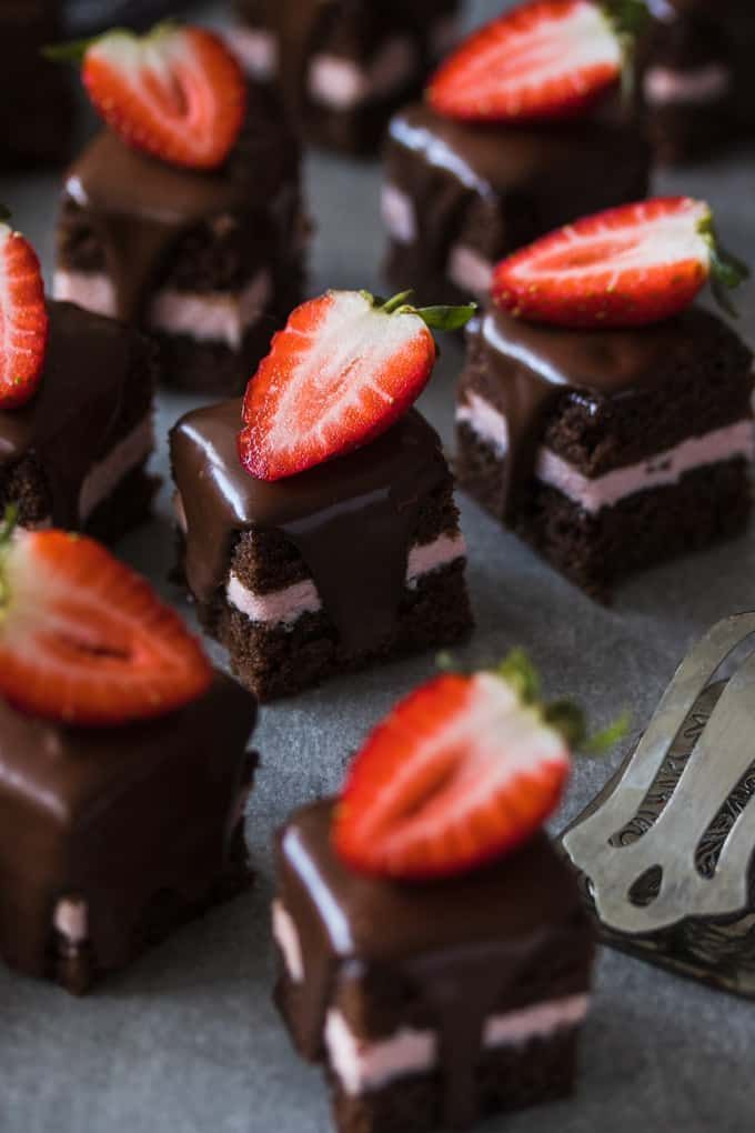 These Strawberry and Chocolate Petit Fours are easy to make chocolate cake filled with strawberry buttercream and topped with chocolate ganache.
