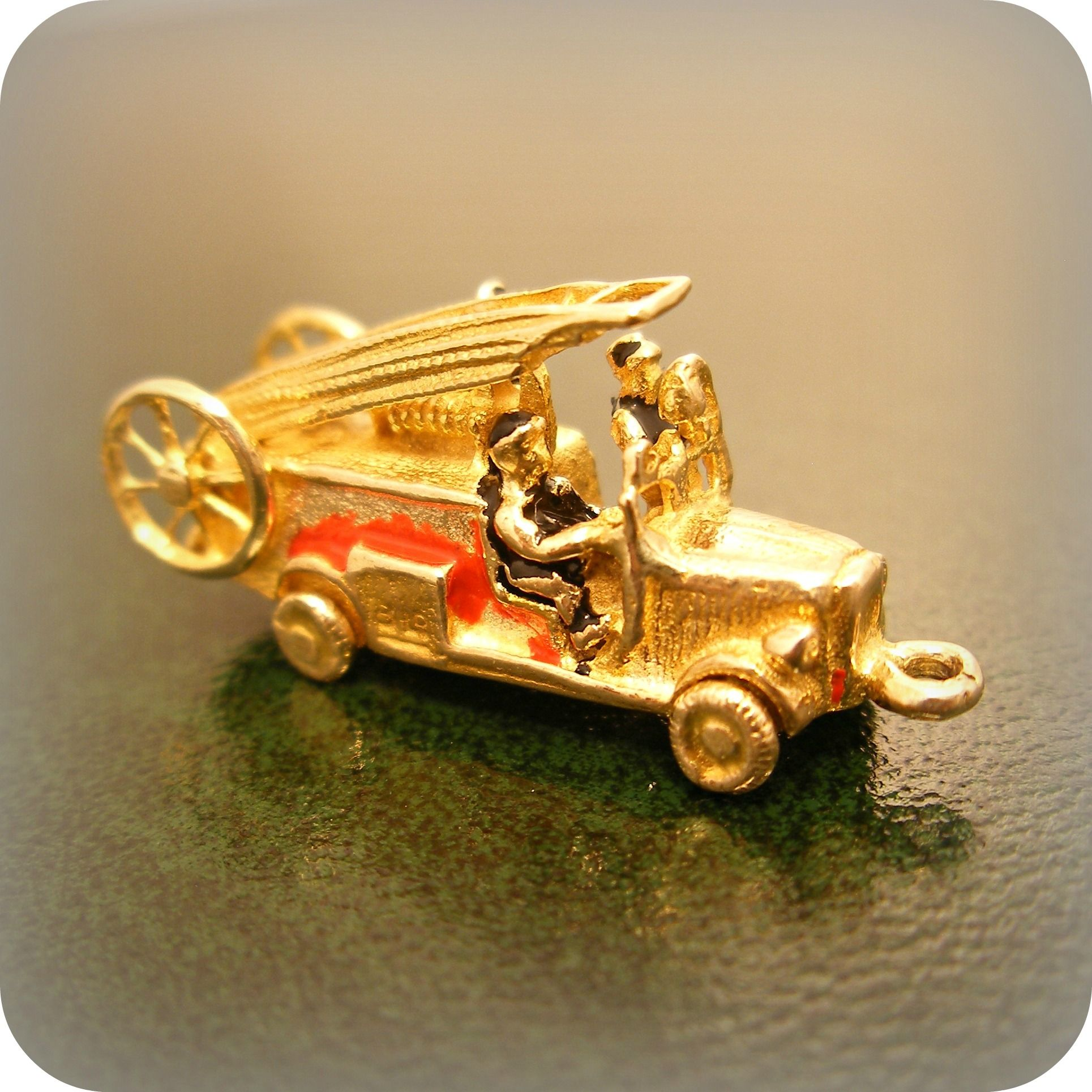 An extremely collectable vintage gold Fire Engine charm ...