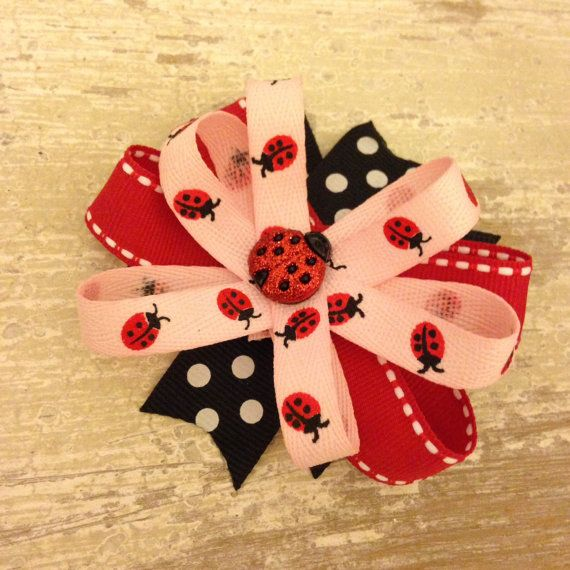 Adorable 3 inch bow with a cute ladybug embellishment in the center. Perfect for a little girl. Have a baby with no hair? No problem! This bow