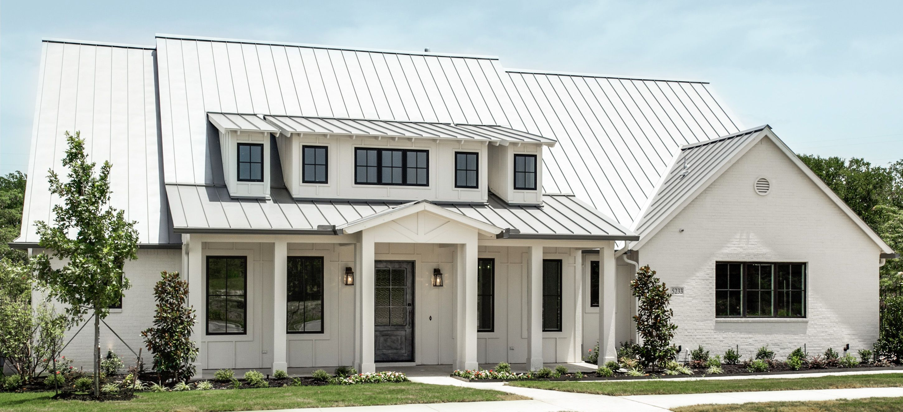 Modern farm house la cantera metal roof white painted for Farm house model