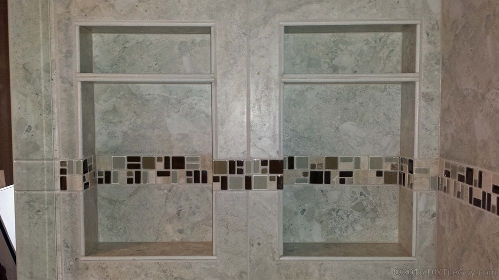Two Shampoo Niches With Glass Mosaic Accent And Tile Shelf