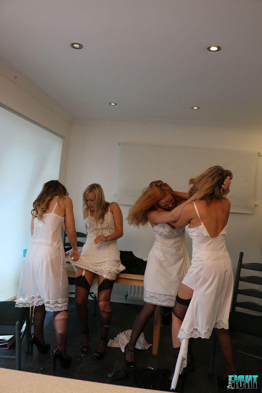 women catfighting in dresses