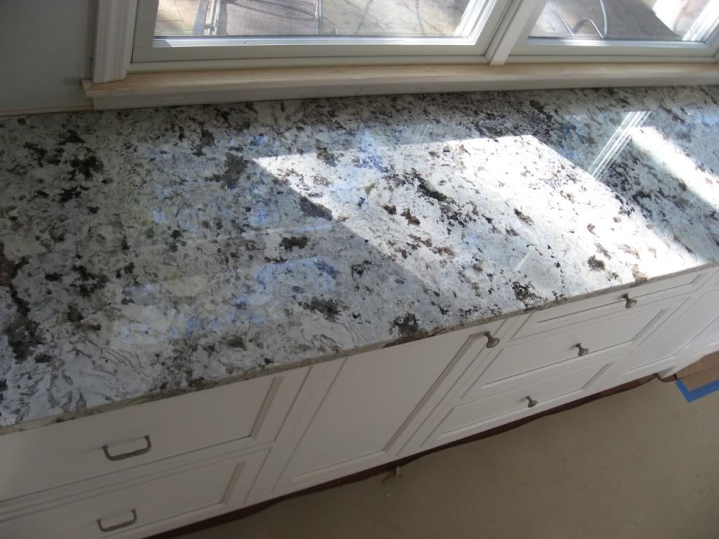 Gray granite countertops with white cabinets re granite for White kitchen cabinets granite countertops