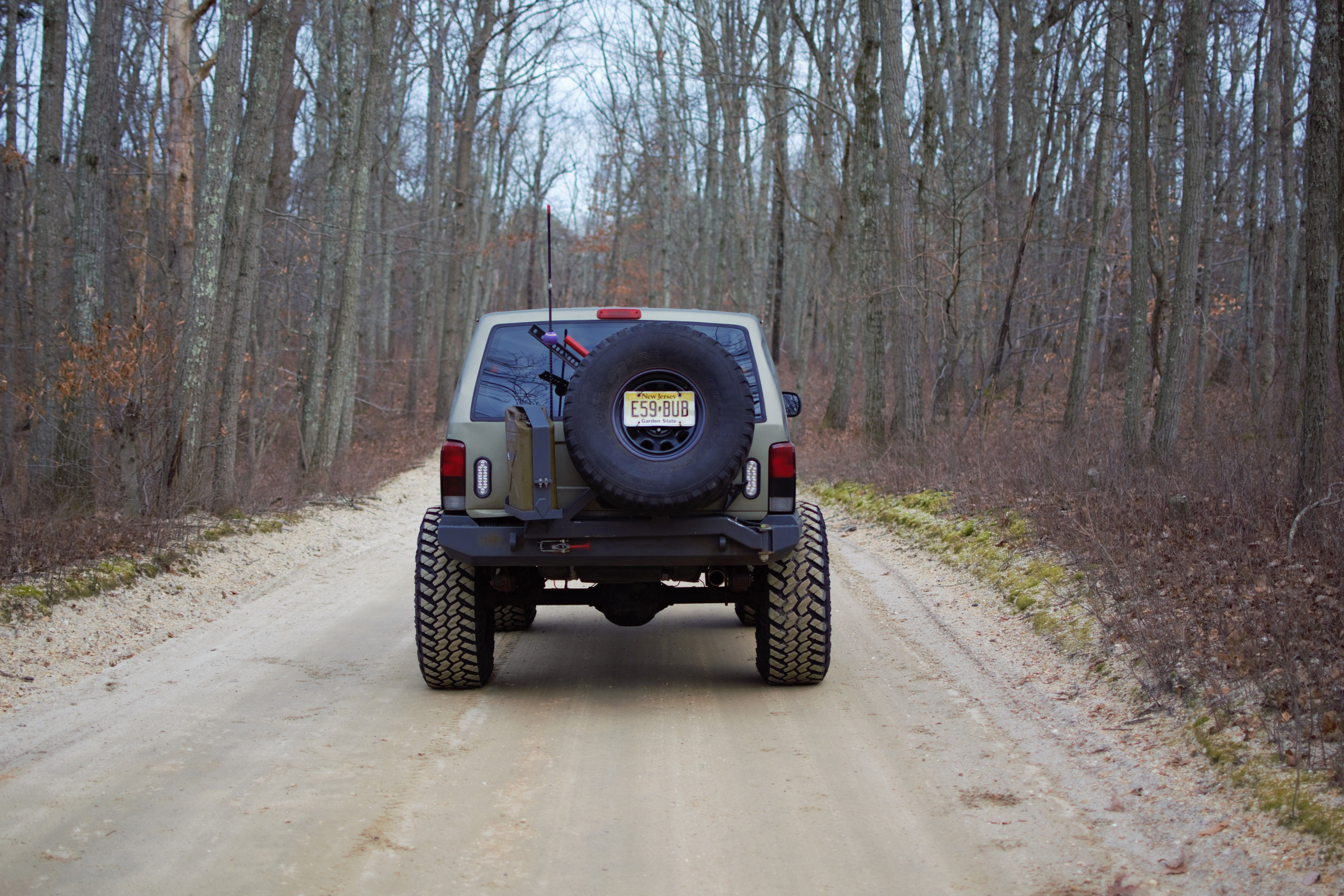 Jeep swinging tire carrier gas can
