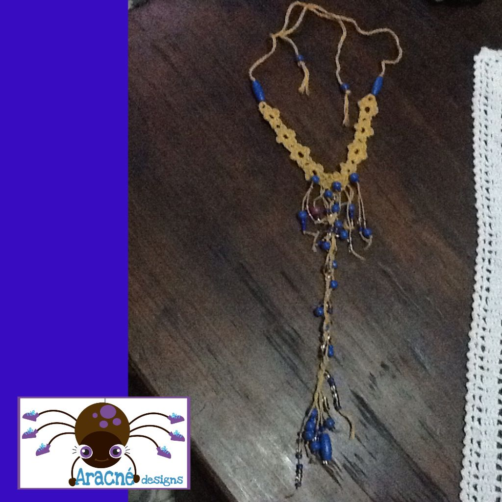 Crochet necklace with glass and wooden beads.