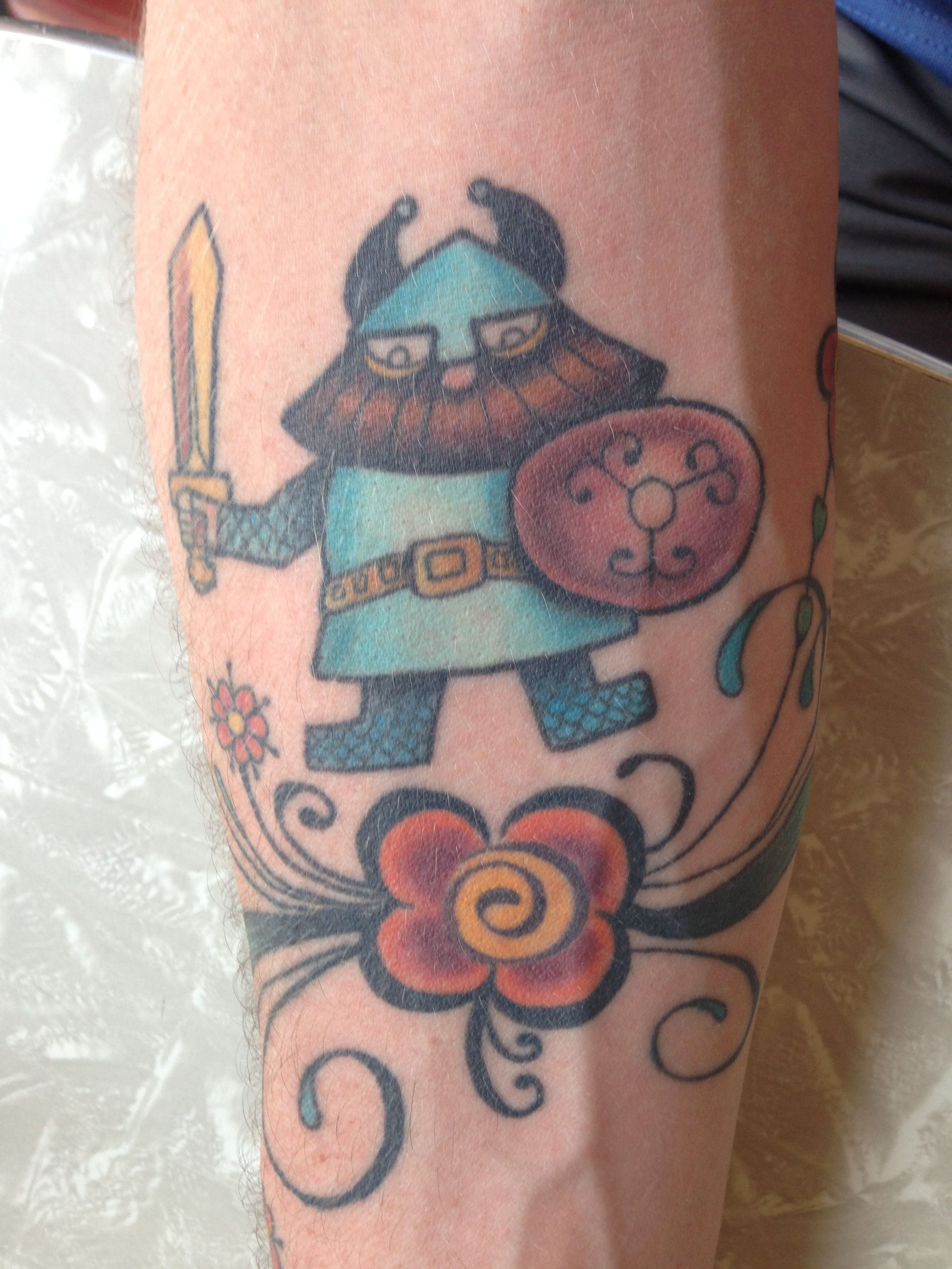 Adorable Viking tattoo with rosemaling. Could be cute w/a