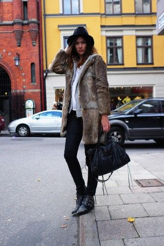 floppy felt hats, skinny black jeans, studded ankle boots and furry textured oversized coats rule for fall/winter style