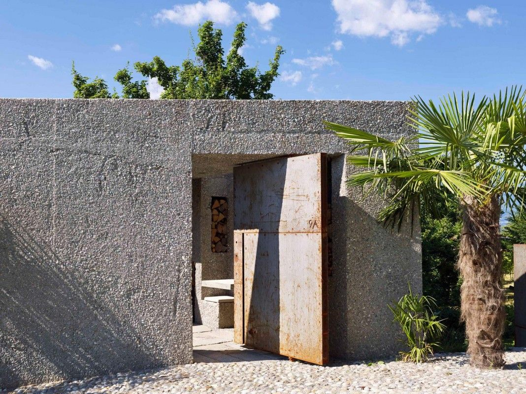 Tiny Concrete Bunker Opens to a 3-Story Home Filled With Light - http://freshome.com/tiny-concrete-bunker-opens-to-3-story-home/